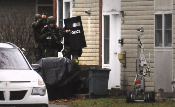 Police enter the apartment at 49 Bolling Drive in Bangor on Tuesday, Nov. 13, 2012. They found the body of a person inside but would not release the identity.