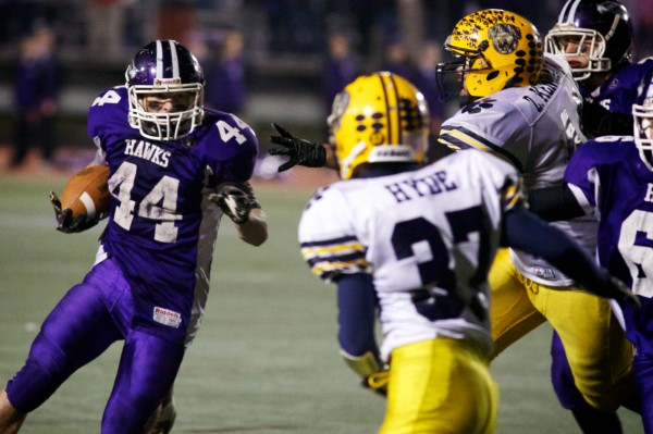 Marshwood High School running back Brett Gerry (44) tries to run around the defense at the Football Class B State Championship game in Portland Saturday night Nov. 17, 2012.Watch the video at bangordailynews.com. (Bangor Daily News photo by Troy R. Bennett)