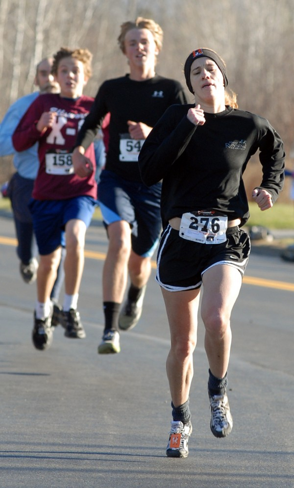 Kristine Guaraldo of Brewer was the first woman to finish the 31st annual Turkey Trot on Sunday with a time of 18:54 on Nov. 18, 2012.