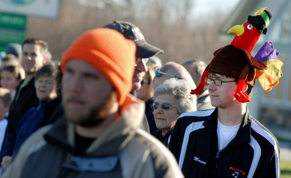 Mason Duplissie, 16, sports a turkey hat while watching his sister, Aubrey, 13, compete in the kids 1- mile Turkey Trot Sunday afternoon. Aubrey won for the girls with a time of 6:19 and Mason celebrated his 16th birthday at the race.  This year's 3-mile race presented by the sophomore class of Brewer High School was the largest turnout so far with 781 runners participating.