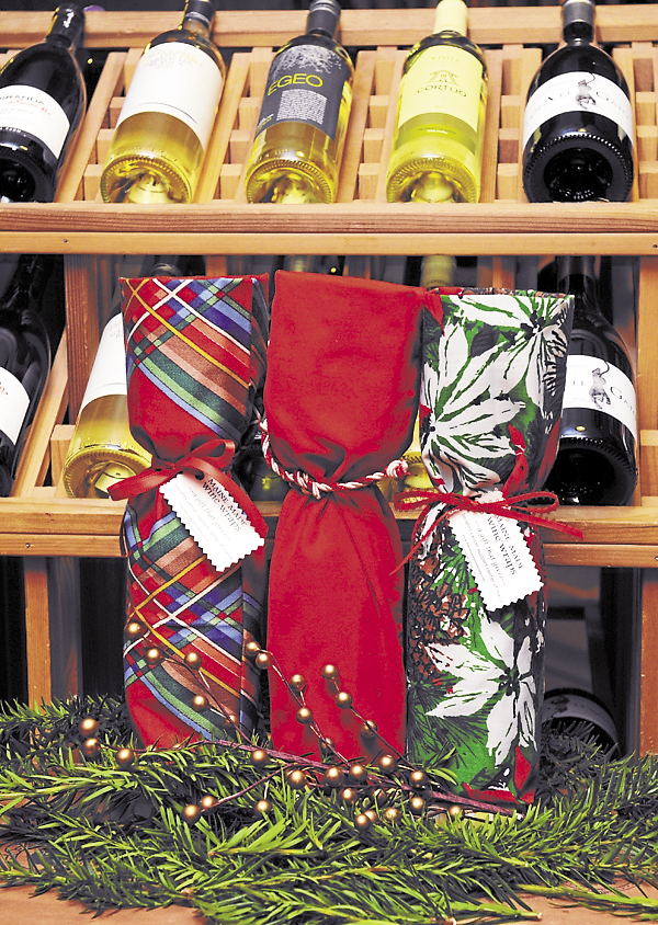 Holiday wine wraps are ready to accent holiday gift giving. Buying a wine wrap from Maine Made Wine Wraps ensures that 100 percent of the proceeds go to benefit the Cancer Support Center of Maine.