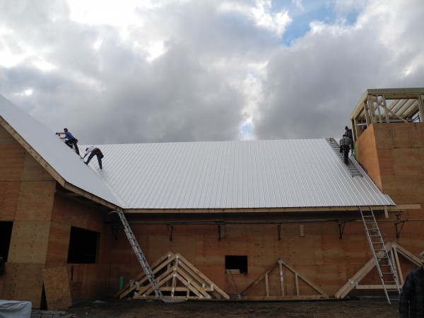 Members of the Amish community worked Thursday to put a roof on the Thorndike Congregational Church. The 103-year-old church was destroyed in December 2011 in an electrical fire.
