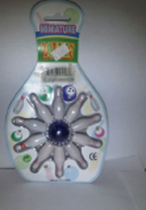 Bowling game by www.coolnoveltyproducts.com is a problem because of small parts and a label violation.
