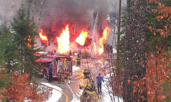 Flames shoot out windows and doors of a house on Stackpole Way in Ellsworth around 3 p.m. Thursday. Nov. 8, 2012.