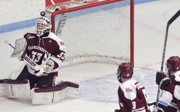 UMass hockey players Steven Guzzo (9) and Conor Allen (4) watch to see if goalie Kevin Boyle (33) will come up with a loose puck in front of the open net in the first period of their NCAA college hockey game against Maine in Orono, Maine, Friday, Nov. 16, 2012.