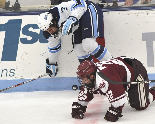 Maine forward Ryan Lomberg (7) collides with UMass forward Troy Power (22) for control of the puck against the boards in the first period of their game in Orono, Maine, Friday, Nov. 16, 2012.