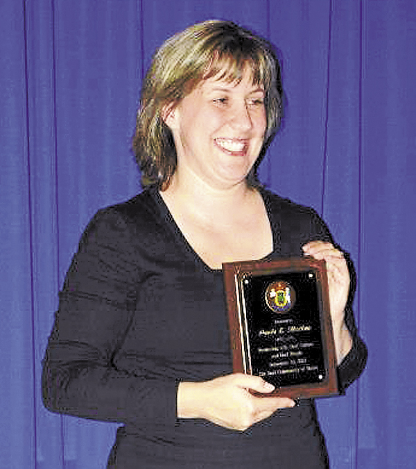 Paula Matlins shows off the Promoting American Sign Language, Deaf Culture and Deaf People Award at the annual Deaf Culture Tea Awards, held Sept. 20 in Augusta.