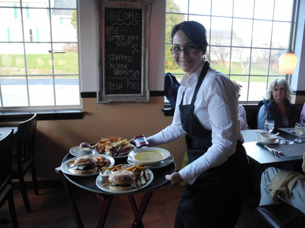 Waitress Michelle Pooler gets ready to serve plates of burgers and bowls of soup Monday at the new Route One RoadHouse in Searsport.