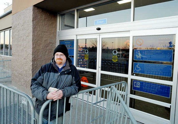 Kevin of Buckfield is the first in line at Walmart in Auburn on Thursday, Nov. 22, 2012. Kevin, who did not want to reveal his last name, waited for the store to open at midnight so he could Christmas shop for his five children.