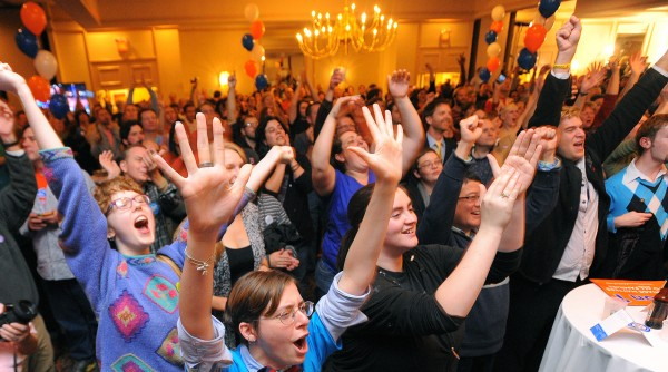 People react to the news that Barack Obama was re-elected at the Mainers United for Marriage campaign party at the Holiday Inn in Portland. Hundreds of people gathered to watch the election returns on Tuesday night.