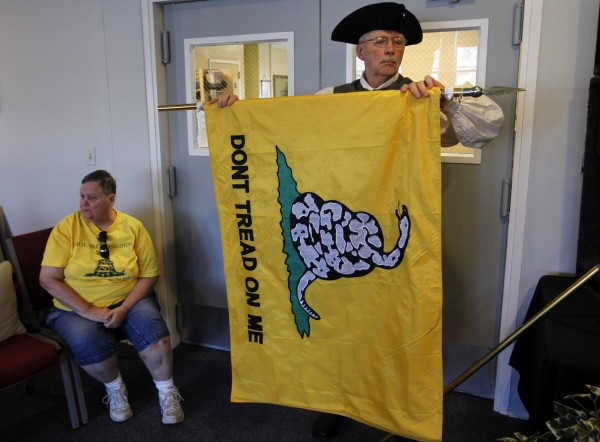 Tea Party member Russell Cumbee rolls up a Gadsden flag following a &quotFood for Free Minds Tea Party Rally&quot in Littleton, N.H., in October.