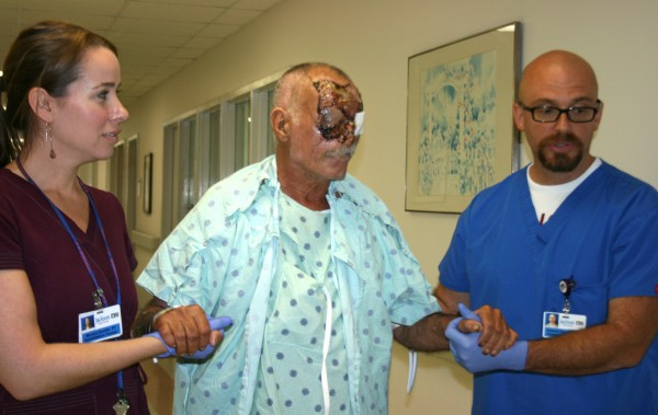 Jackson Memorial Hospital personnel assist Ronald Poppo, who was attacked on the MacArthur Causeway in Miami, Fla., leaving him mutilated and blind.