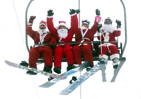 A group of Santas ride a chairlift, Sunday, Dec. 2, 2012, at the Sunday River Ski Resort in Newry. More than 250 skiers and snowboarders participated in the annual Santa Sunday event to raise money to benefit the Bethel Rotary Club's Christmas for Children program.
