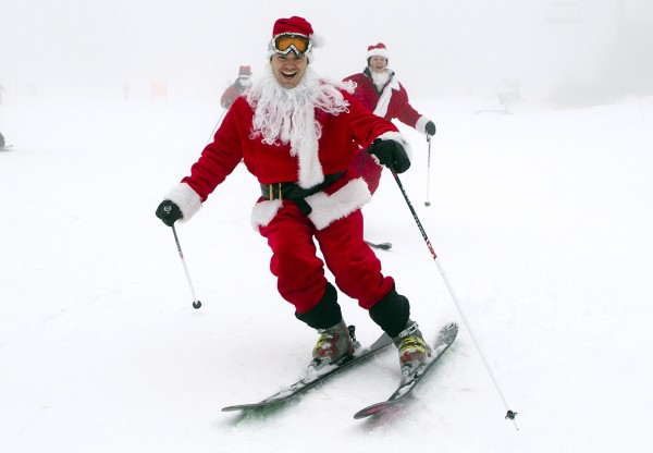 A man dressed as Santa skiis down the slopes at the Sunday River Ski Resort in Newry, Maine, Sunday, Dec. 2, 2012. More than 250 Santas participated in the annual event to raise money to benefit the Bethel Rotary Club's Christmas for Children program.
