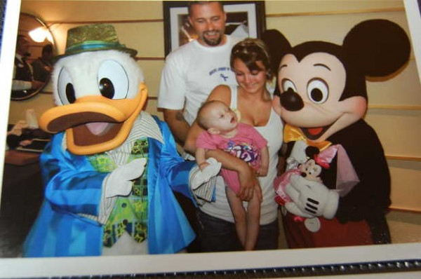 Addilyn Davis met Mickey Mouse and Donald Duck on a family trip to Walt Disney World Resort in Florida in May. Parents Kyle and Jamie Davis of New Sharon watch her react to Mickey, whose voice puts a smile on her face, her family said.