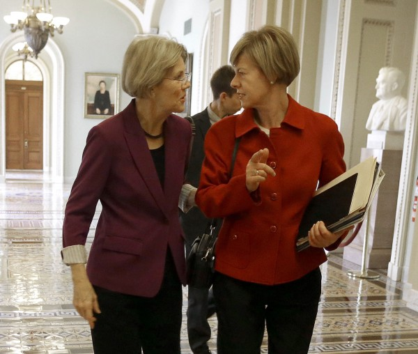 Sen-elect Elizabeth Warren, D-Mass., left, and Sen-elect, current Rep. Tammy Baldwin, D-Wis. walk together on Capitol Hill in Washington on Nov. 13. A record-breaking 20 women will serve in the Senate next year,