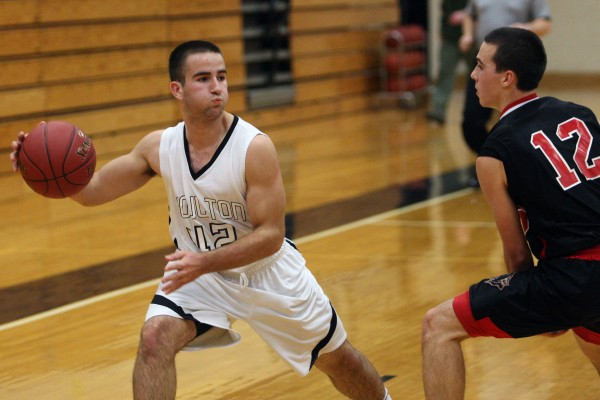 Sophomore guard Jacob Drew (left) of Houlton looks to pass the ball past Katahdin defender Billy Livezey during a Nov. 29 scrimmage in Houlton.