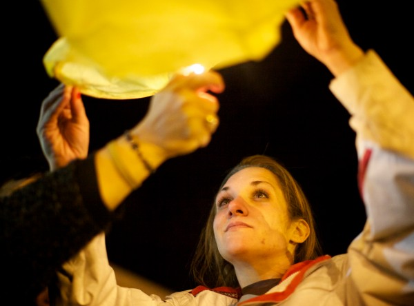 Trista Reynolds, mother of missing toddler Ayla Reynolds, releases a lighted paper lantern into the night sky in Portland on Saturday, marking the one-year anniversary of Ayla's disappearance.
