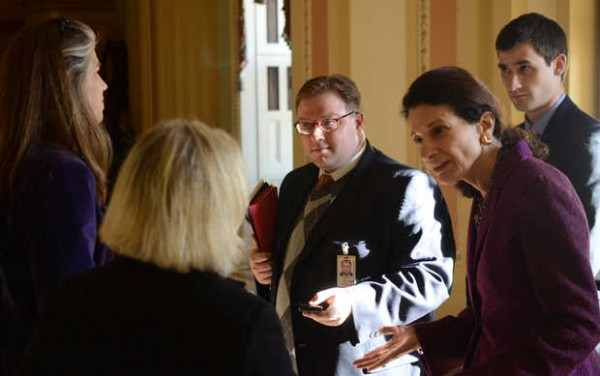 U.S. Sen. Olympia Snowe speaks with reporters at the Capitol after she delivered her farewell address. At left is Christopher Averill, Snowe's communications director, and behind her to the right is Scott Ogden, her deputy press secretary.