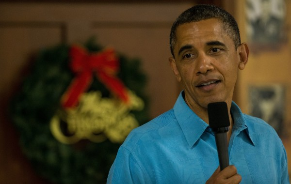 President Barack Obama delivers remarks while visiting military personnel eating Christmas dinner at Anderson Hall at Marine Corps Base Hawaii.