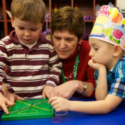 Rosalie Perkins, a pre-K teacher at the Woolwich Central School, talks about shapes and lines with students Garrett Craney (left) and Payson Bowling on Thursday, Dec. 20, 2012.