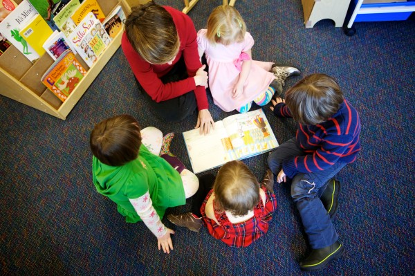 Pre-K ed-tech Katie Smith (in red) reads a story at the Woolwich Central School on Thursday, Dec. 20, 2012.