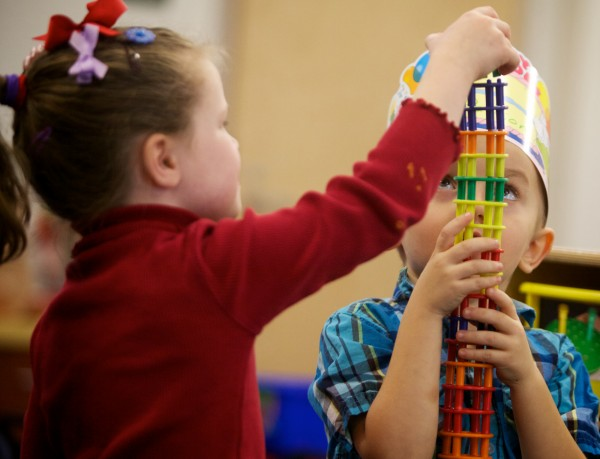 Mallory Doak and Payson Bowling make a tower in a pre-K class at the Woolwich Central School on Thursday, Dec. 20, 2012.