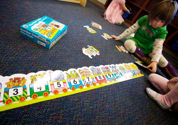 Kendall Darling puts a number puzzle together in a pre-K class at the Woolwich Central School on Thursday, Dec. 20, 2012.