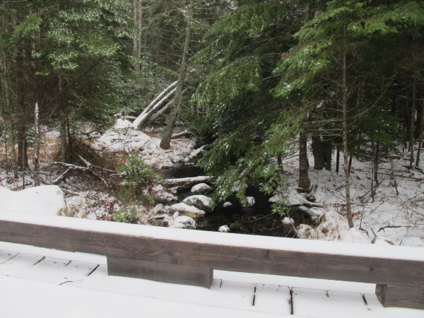 A bridge passes over a gurgling brook on the access road to Branch Lake Public Forest in Ellsworth on Dec. 10, 2012.