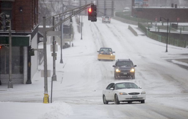 Traffic moves slowly up snow covered roads on Union Street on Thursday morning in Bangor. A storm that hit Maine on Thursday could bring as much as 18 inches of snow to some areas.