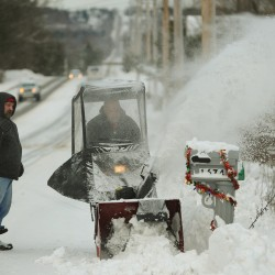 Rick Bragg (left) and Jerry Watson clear snow from their mailbox along Union Street in Bangor on Friday, Dec. 28, 2012. People across the region were clearing driveways and raking roofs after Thursday's snowstorm dumped 7 inches of snow on the Bangor area according to the National Weather Service. Houlton residents got 16.5 inches of snow according to the National Weather Service.