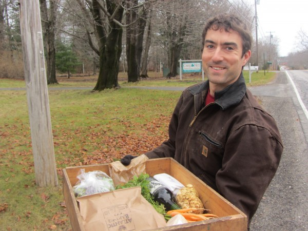 Jesse Wheeler displays the items delivered to homes in Rockland by horse-drawn carriage.