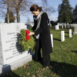 Sen. Olympia Snowe R-Maine lays a holiday wreath over the grave of Lieutenant Edmund Sixtus Muskie at Arlington National Cemetery in Washington in December 2011, during Wreaths Across America Day.