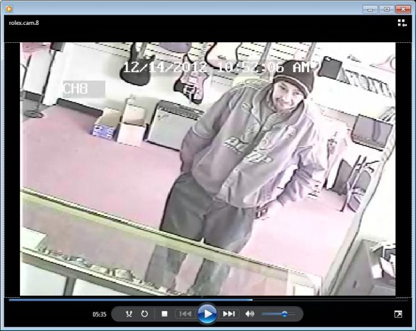 A surveillance camera in a local pawn shop captured a man police say tried to sell a stolen Rolex watch.