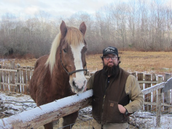 Brian Smith and his Belgian draft horse Don at the Oyster River Winegrowers farm in Warren.