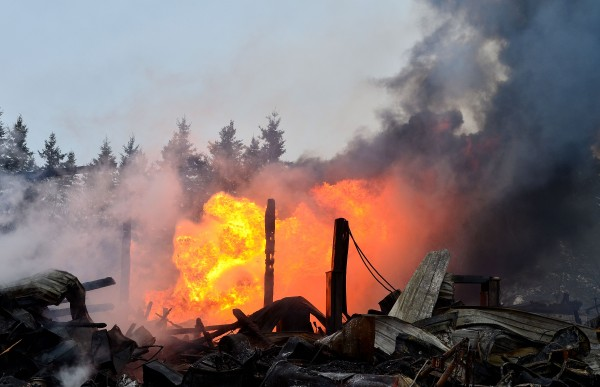 Crews from three departments responded just after 9:30 a.m. to the fire at Benn Auto Sales, Inc., on Calais Road and found the three-story barn housing the business fully involved, according to Rick Tidd, assistant chief of the Hodgdon Volunteer Fire Department.