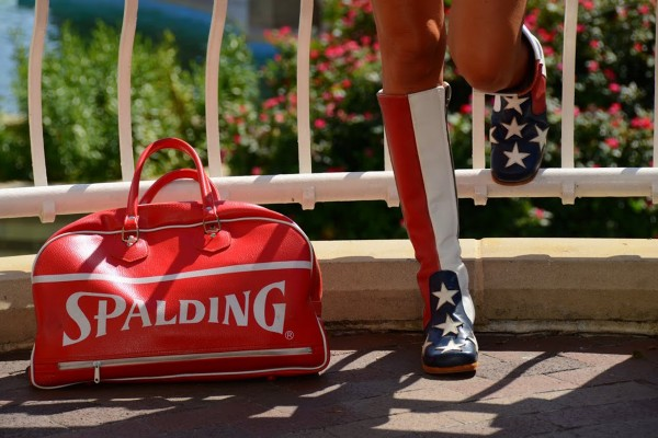 Siobhan McDonough, author of the 2012 book &quotMy Mother's Dressing Room,&quot models vintage American flag boots beside a vintage Spaulding bag.