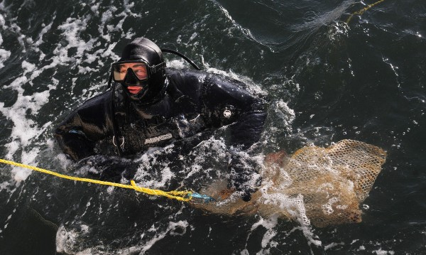 Commercial diver Ed Monat gets ready to dive for scallops near Bartlett Island in Blue Hill Bay Sunday.