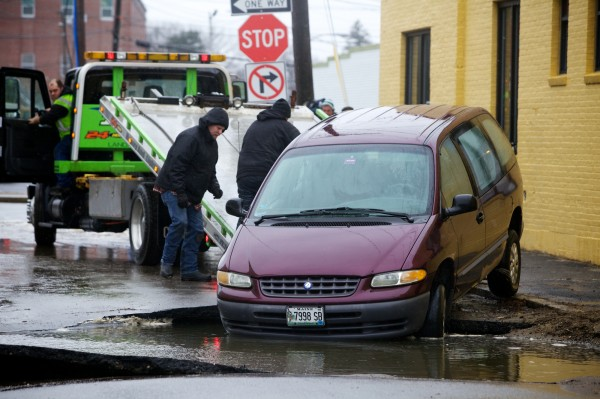 A van is pulled from a sink hole on Somerset Street in Portland on Wednesday morning, Dec. 19, 2012 after a water main break.