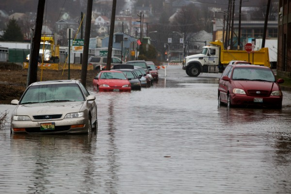 Cars emerge from the receding waters on Somerset Street in Portland on Wednesday morning, Dec. 19, 2012 after a water main break.
