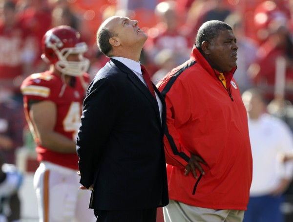 Kansas City Chiefs general manager Scott Pioli (left) and coach Romeo Crennel stand together before an NFL football game against the Carolina Panthers at Arrowhead Stadium in Kansas City, Mo., Sunday, Dec. 2, 2012. On Saturday, Kansas City Chiefs linebacker Jovan Belcher thanked Pioli and Belcher for giving him a chance in the NFL, before he turned away and fatally shot himself.