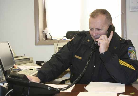 Doug Conroy, chief of the Washburn Police Department, spent his last day on the job, Nov. 30, 2012, responding to well-wishers who called and stopped by to visit with him and thank him for his many years of service.