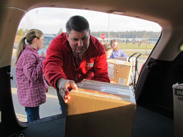 Todd Nadeau, executive director of the Maine chapter of the American Red Cross, and Jordyn Bray, a fifth-grader at Ellsworth Elementary-Middle School, load up an SUV with dozens of boxes of donations for victims of Superstorm Sandy.