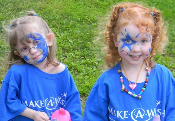 Paige Lento (left) and her sister Chloe take part in an event for the Make A Wish Foundation. Paige, 7, was born with Jeune syndrome, a rare genetic disorder that affects the way a child's cartilage and bones develop. The condition often causes life-threatening complications.