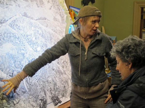 Kehben Grier, of Beehive Design Collective in Machias, explains the collective's newest portable mural, &quotMesoamerica Resiste,&quot to an audience at Machias Grange Hall on Friday, Dec. 7, 2012.
