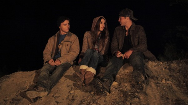 Dominic (Callen McAuliffe), Emma (Sarah Sutherland) and Casper (Emory Cohen) talk at a gravel pit party in a scene from the new film &quotBlue Potato,&quot shot in Van Buren.