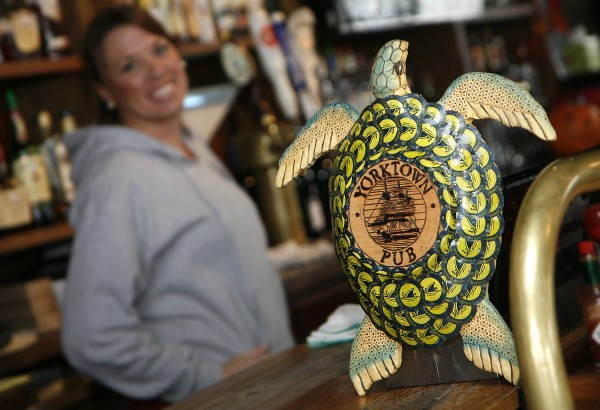 Paul and wife Pam Cochrane (both not pictured) transform bottle caps into folk art, including mermaids, starfish, fish of all types, crabs and sea turtles, marketed under the name Beach House Bottlecap Art. Paul gets most of his caps from the Yorktown Pub, he made this turtle for them.