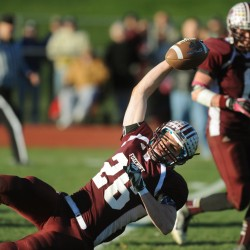 Foxcroft Academy's Don Boyer stretches the ball across the goal line in Foxcroft's Eastern Maine Class C championship win over John Bapst on Nov. 10. Boyer has been named the LTC's player of the year.
