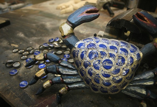 Paul and wife Pam Cochrane transform bottle caps into folk art, including mermaids, starfish, fish of all types, crabs and sea turtles, marketed under the name Beach House Bottlecap Art. Here, Popular Bud Light crab.