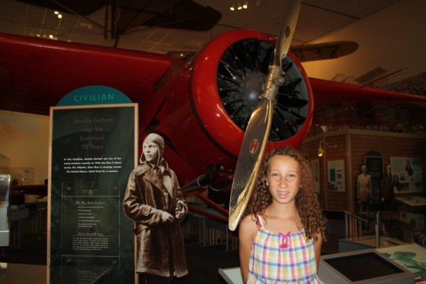 Mary Brenna Catus poses in front of an airplane flown by Amelia Earhart in August in the Smithsonian Institute's Air and Space Museum.